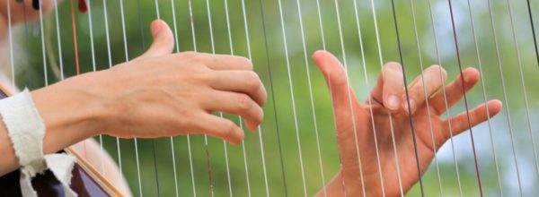 """Waiting on God"" online inspirational talk - image of hands sweeping over harp strings"